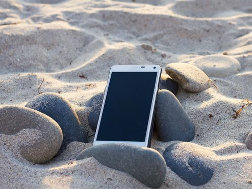 Tatsächlich Urlaub oder mit dem Firmenhandy am Strand?